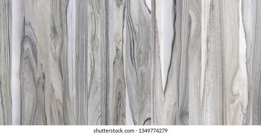 A fragment of a wooden panel hardwood. Walnut.
