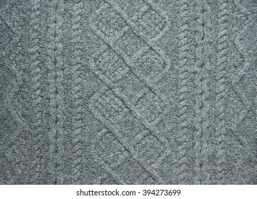 a fragment of wool garment with ornament