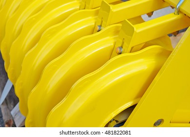 Fragment of  yellow industrial seeder