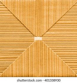 fragment of yellow  paper envelope