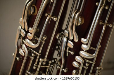 fragments of bassoons on a neutral background in deep and saturated colors