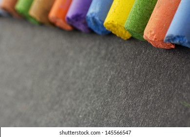 fragments of bright color pastels, adjusted in a row