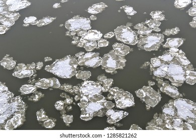Fragments of ice float on the river. Ice drift in winter. An ice floe or float is a large pack of floating ice
