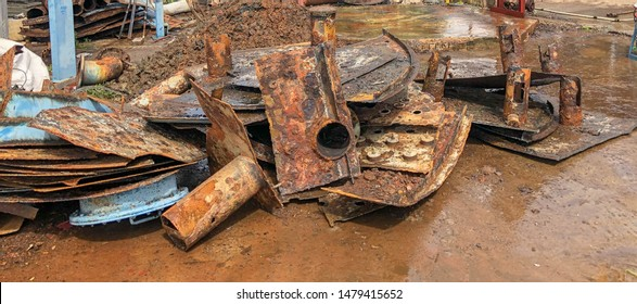 Fragments of old cast-iron water pipes. After many years of operation corroded metal pipe was destroyed. Rusty steel tube with holes of metallic corrosion. Rusty cast iron, metal - Image