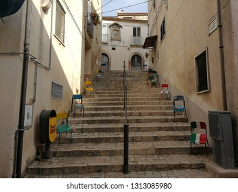 Fragneto Monforte, Benevento, Campania, Italy - October 12, 2018: Small painted chairs along the steps of the historic center