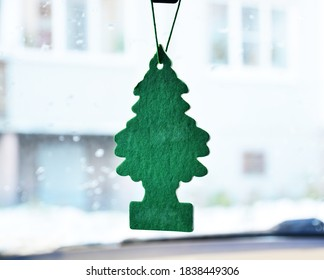 fragrance for the car interior, made in the form of a green tree. concept of fresh air, new year and christmas. copy space.