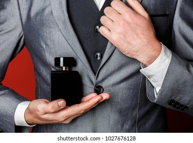 Fragrance smell. Male fragrance, perfumery, cosmetics. Smell perfume. Expensive suit. Rich man prefers expensive fragrance smell. Man scent perfume. Perfume or cologne bottle. Fashion cologne bottle.