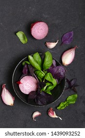 fragrant basil herbs in a plate on a black food background