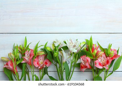 Fragrant beautiful alstroemeria on a wooden background