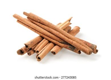 fragrant cinnamon sticks over white background