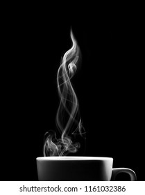 Fragrant coffee on a black background for your advertising. Smoke from hot coffee.