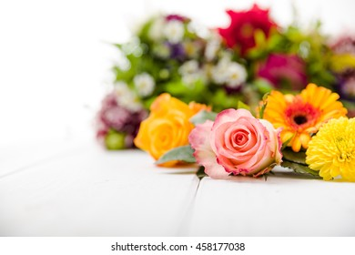 Fragrant flowers on white wooden background