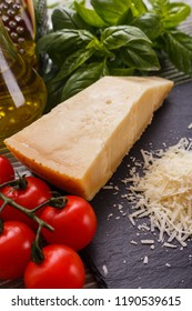 fragrant grated Parmesan on a slate stone slicing board