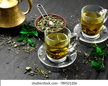 fragrant green tea in a glass cups. On the black chalkboard