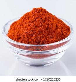 fragrant ground paprika on a white acrylic background