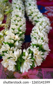 Fragrant hei necklace made with fresh tiare flowers in Tahiti, French Polynesia