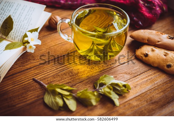 fragrant herbal tea fresh cookies and nuts lying on a wooden table