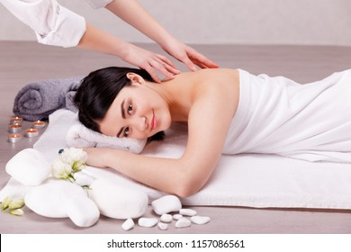 A fragrant massage on the floor.Young woman enjoying massage in spa salon