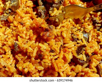 Fragrant pilaf, fried rice with meat and vegetables. Closeup. A traditional dish of Asian cuisine.