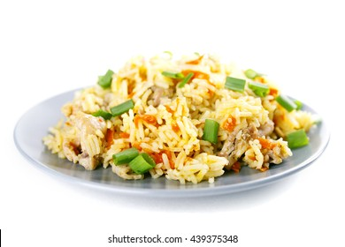 Fragrant Pilau/Pulav / pilaf /pilaf,  fried rice with meat and vegetables on a grey plate. Isolated on white. Macro.