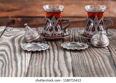 Fragrant Turkish tea and Turkish sweets in national dishes