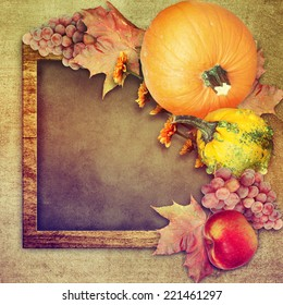 Frame with autumn fruits and pumpkins.