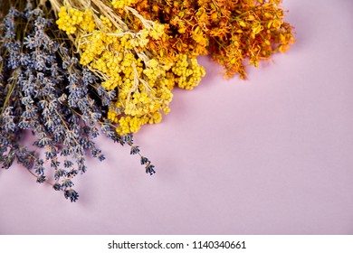Frame  background from dry herbs flower - tutsan, sagebrush, oregano, helichrysum, lavender. Aromatherapy. Medicinal. Copy space. Flat lay Top view