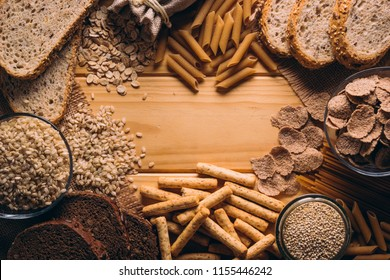 Frame with best know Whole-grain foods on a wooden table