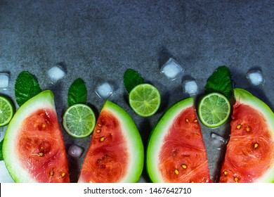 Frame or border of fresh watermelon slices with lime, mint and ice. Top view, place for text, copy space.