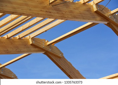 The frame of the building of laminated veneer lumber. Roof construction of laminated veneer lumber. Building. Glued laminated timber.
