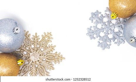 Frame of Christmas decorations isolated on a white background