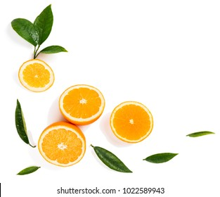 Frame from citrus slices( orange fruit) and green leaves of orange tree isolated on white background, top view.