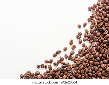 Frame of coffee beans on white background with area for copy space.