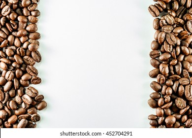 Frame with coffee beans on white background