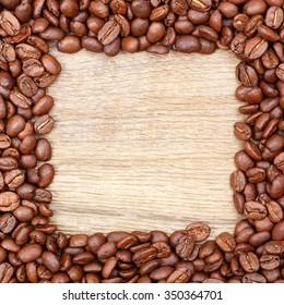 "Frame of Coffee Beans, Wooden Background: ""Coffee"" white letters."