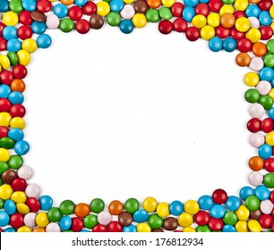 Frame of colorful candy on a white background with space for your text