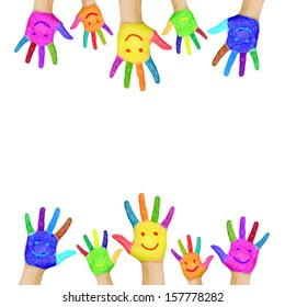 Frame of colorful hands painted with smiling faces. Fun, joy, happiness and good cheer. Baby, child and adult hands, ready for your logo, text or symbols. Joyful party. Isolated on white background