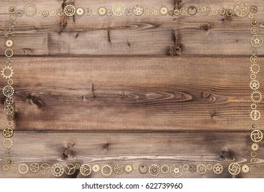 The frame is decorated with gears, on wooden background in steampunk style.