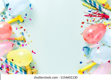 Frame of decoration party on pastel blue background top view, flat lay