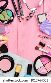 Frame from decorative cosmetics, copy space. Fashion cosmetic products flat lay, space for text.