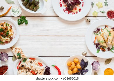 Frame of delicious snacks on white table flat lay. Top view on assortment of tasty breakfast meals, free space on white wooden background. Buffet, restaurant menu, banquet concept