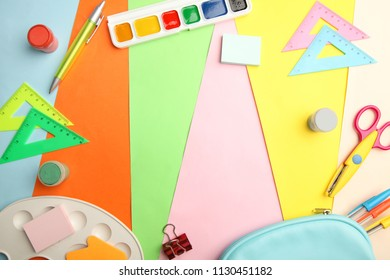 A frame from different school supplies on a bright background.