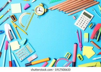 Frame of different stationery on light blue background, flat lay with space for text. Back to school