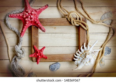 Frame with Few marine items on a wooden background . Sea Objects over wooden planks