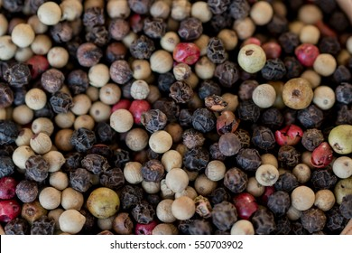 Frame filled with mixed peppercorns