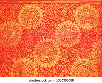 Frame filling closeup view of Banares silk sari. These exquisite, expensive sarees are famous for their gold and silver zari, brocade. Incredible India.