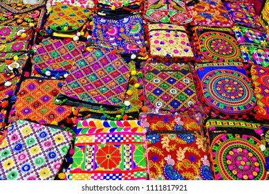 Frame filling image of colorful, handcrafted cotton hand bags for sale in the Law Garden night market, Ahmedabad. overhead composition.