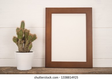 Frame and flower on the table