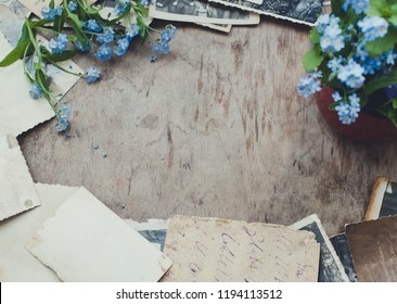 Frame with flowers and old photo