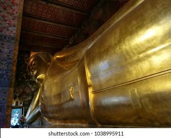 frame focus of Reclining Buddha gold statue. Wat Pho, Bangkok, Thailand